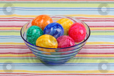 Colorful eggs stock photo, Boiled colorful easter eggs in a bowl by Birgit Reitz-Hofmann
