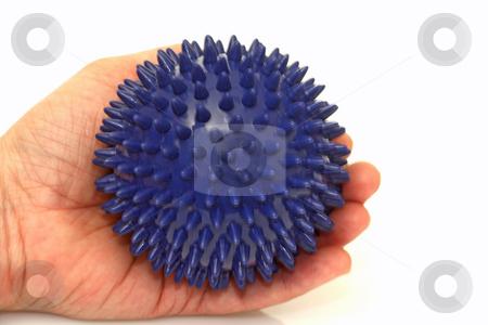 Massage ball stock photo, Prickly massage ball in hand on bright background by Birgit Reitz-Hofmann