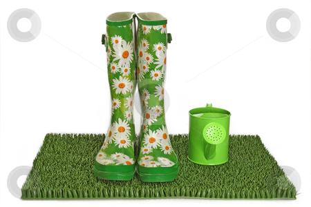Rubber boots stock photo, Pair of black rubber boots on green grass by Birgit Reitz-Hofmann