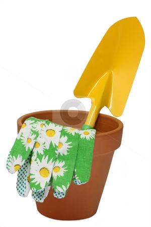 Flower pot stock photo, Flower pot with garden shovel isolated on white background by Birgit Reitz-Hofmann