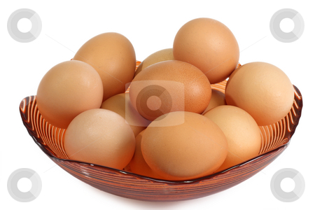 In a bowl stock photo, Brown eggs in a bowl on bright background by Birgit Reitz-Hofmann
