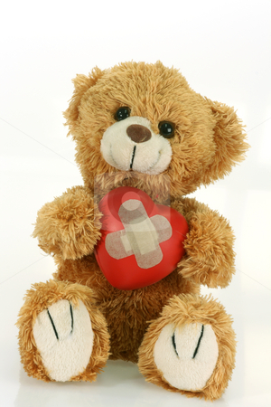 Love sick stock photo, Cute teddy bear with decorative heart on bright background by Birgit Reitz-Hofmann