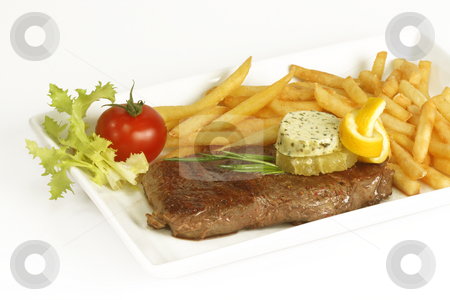 Beef steak stock photo, Grilled beef steak with french fries and sauce served in plate. by Birgit Reitz-Hofmann