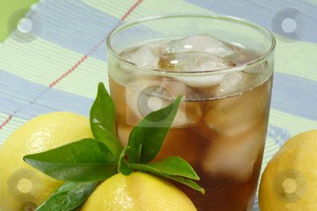 Lemon ice tea_19 stock photo, A glass full of Ice Tea with a lemon slice on green background by Birgit Reitz-Hofmann