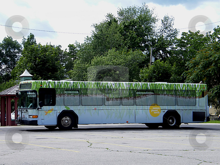 Restore Planet Earth - Tarta Bus stock photo, Restore Planet Earth - a Toledo Ohio Area Tarta Bus (used for public transportaion) which was given a new 'go green look' for the Art in Tarta Project. Writing on the bus says