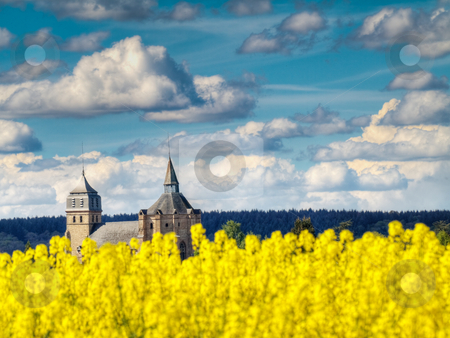 Colza field and church stock photo, Colza field and Ibos church HDR processed by Laurent Dambies