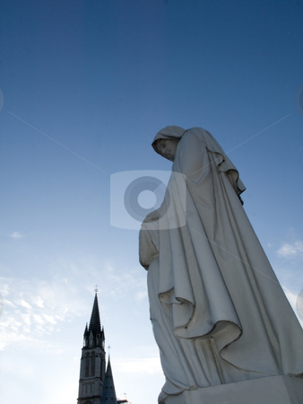 Virgin Mary statue in Lourdes stock photo, Basilica of the Immaculate Conception in Lourdes with statue of the virgin Mary by Laurent Dambies