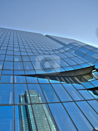 Skyscrapers reflection stock photo, Skyscraper reflection under blue sky by Laurent Dambies