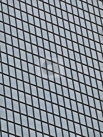 Glass skyscraper stock photo, Details of a glass skyscaper windows by Laurent Dambies