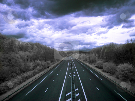 Highway to hell stock photo, Infrared picture of an empty highway with stormy clouds by Laurent Dambies