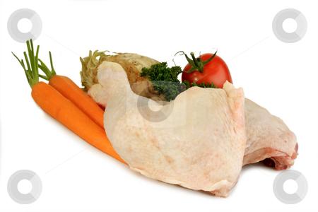 Chicken leg_3 stock photo, Raw chicken leg with vegetables on bright background by Birgit Reitz-Hofmann