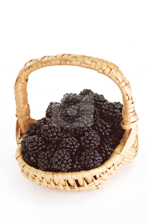 Berry fruit stock photo, Fresh blackberries in a basket on bright background by Birgit Reitz-Hofmann