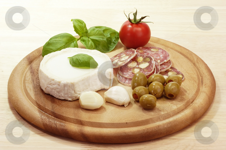 Italian food stock photo, Gourmet food on a brown kitchen board by Birgit Reitz-Hofmann