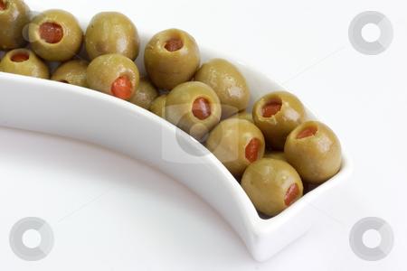 Green olives stock photo, Green olives on bright background by Birgit Reitz-Hofmann