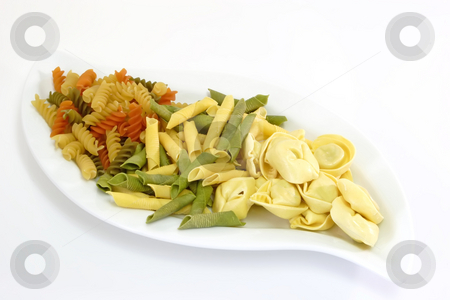 Noodles_6 stock photo, Raw pasta on bright background. Shot in Studio. by Birgit Reitz-Hofmann