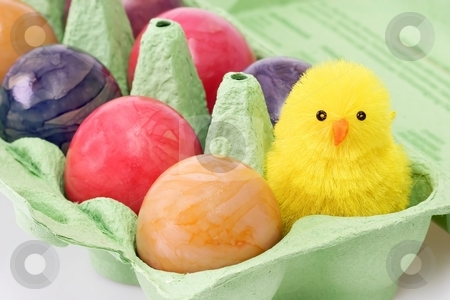 Toy chicken stock photo, Colorful eggs in a carton with toy chicken by Birgit Reitz-Hofmann