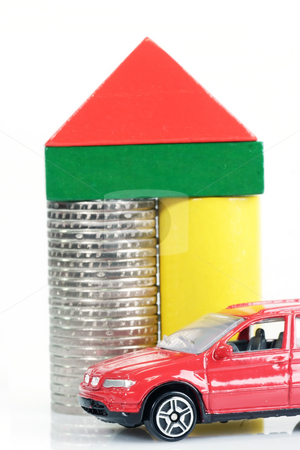 Toy car stock photo, Toy bricks and euro coins and a toy car on bright background by Birgit Reitz-Hofmann