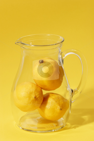 Lemon drink stock photo, Lemons in a glass jug on bright background by Birgit Reitz-Hofmann