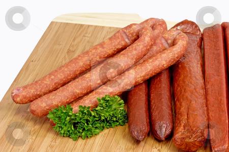 Sausage_9 stock photo, Smoked sausage on a kitchen board by Birgit Reitz-Hofmann