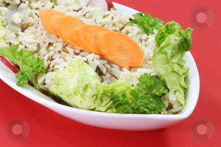 Wild rice stock photo, Wild rice in a bowl on red background by Birgit Reitz-Hofmann