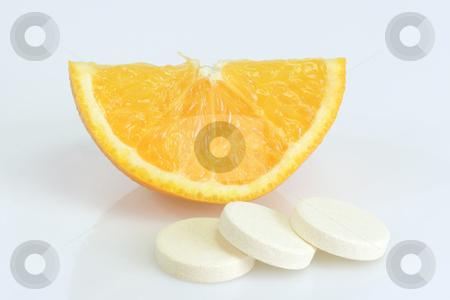 Vitamins_2 stock photo, Large pills with orange fruits tube on bright background by Birgit Reitz-Hofmann