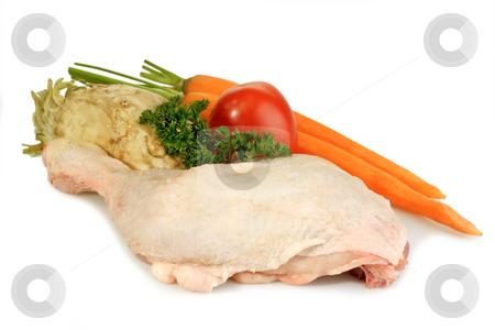 Chicken leg_4 stock photo, Raw chicken leg with vegetables on bright background by Birgit Reitz-Hofmann