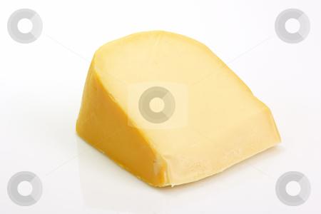 Cheese stock photo, A big chunk of gouda cheese on bright background by Birgit Reitz-Hofmann