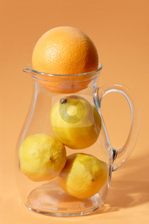 Fruits in a glass jug stock photo, Orange and lemon in a glass jug on bright background by Birgit Reitz-Hofmann