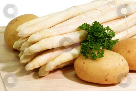 Vegetable stock photo, Fresg asparagus with potatoes on a kitchen board by Birgit Reitz-Hofmann