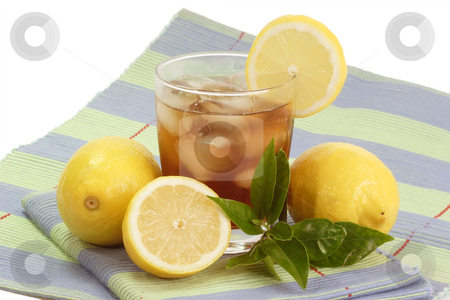 Lemon ice tea_12 stock photo, A glass full of Ice Tea with a lemon slice on bright background by Birgit Reitz-Hofmann