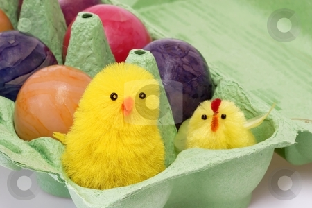 Cute toy chicken stock photo, Colorful eggs in a carton with toy chicken by Birgit Reitz-Hofmann