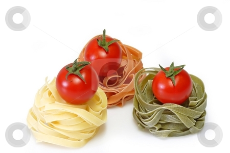 Noodles with Tomato stock photo, Raw pasta on bright background. Shot in Studio. by Birgit Reitz-Hofmann