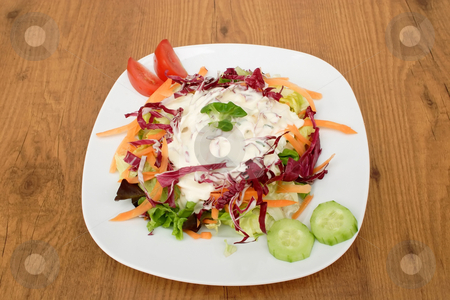 Fresh salad stock photo, Fresh salad on a plate on brown background by Birgit Reitz-Hofmann