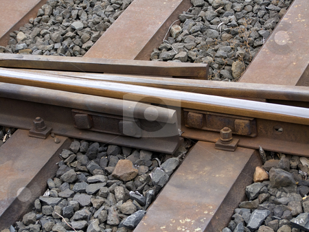 Crossing stock photo, Detail from a train track at the countryside. by Birgit Reitz-Hofmann