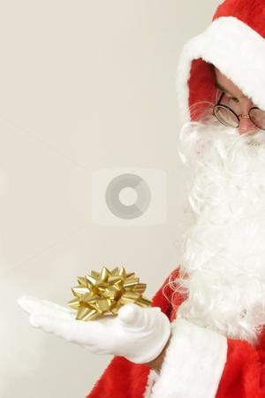 Golden gift ribbon stock photo, Male caucasian model of santa claus on grey background by Birgit Reitz-Hofmann