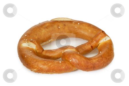 Salted pretzel stock photo, Salted bavarian pretzel on bright background by Birgit Reitz-Hofmann