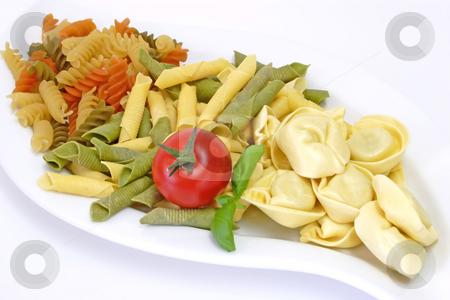 Noodles_4 stock photo, Raw pasta on bright background. Shot in Studio. by Birgit Reitz-Hofmann