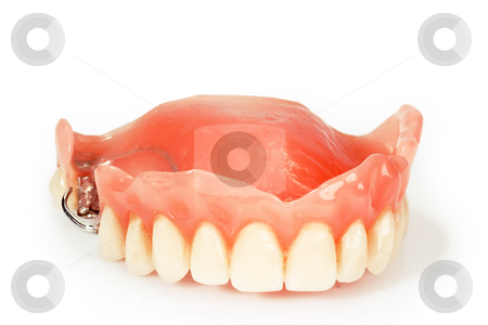 Dental prosthesis stock photo, Dental prosthesis on bright background by Birgit Reitz-Hofmann