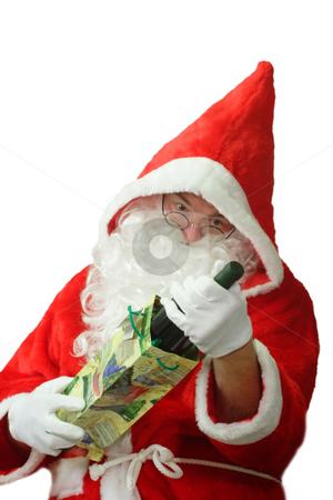 Surprised Santa stock photo, Male caucasian model of santa claus holding a bottle of champaigne - isolated on white background by Birgit Reitz-Hofmann