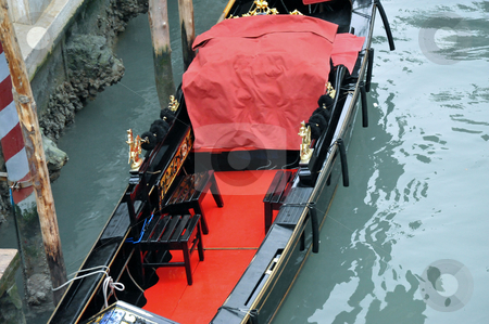 Gondola in canal stock photo, Gondola with red carpet and covering in canal by Jaime Pharr