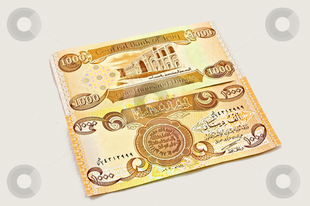 Iraq Dinar Currency stock photo, Closeup of one thousand (1000) Iraqi dinar currency, front and back isolated on a white background. by Valerie Garner