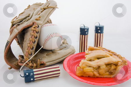 Apple Pie, Baseball and 4th of July Candles stock photo, Closeup photo of apple pie on a red plate, baseball mit & ball, and 4th of July flag patterned candles creates an all American theme.  Isolated on a white background. by Valerie Garner