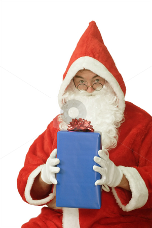 Christmas Surprise stock photo, Male caucasian model of santa claus holding a blue giftbox - isolated on white background by Birgit Reitz-Hofmann
