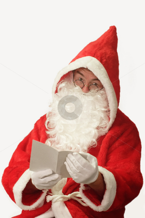 Wish List stock photo, Male caucasian model of santa claus holding a sheet of paper - isolated on white background by Birgit Reitz-Hofmann
