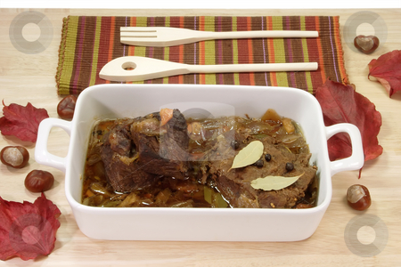 Marinated beef_4 stock photo, Cooked marinated beef meat in a bowl with wooden spoon. by Birgit Reitz-Hofmann