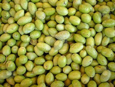 Fresh green olives stock photo, Pile of fresh green Olives just harvesting by Birgit Reitz-Hofmann