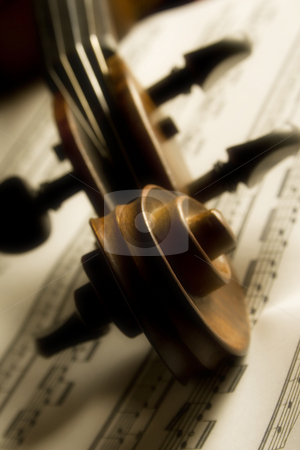 Violin stock photo, Shot of violin head over partiture, soft focus throughout the entire image gives it a