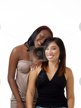 Teen black and hispanic girls double portrait stock photo, Two young women black and hispanic smiling portrait by Jeff Cleveland