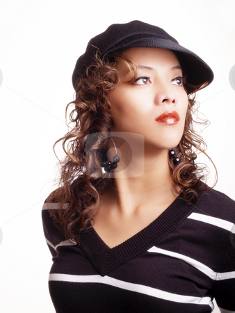 Young hispanic woman in black hat and sweater stock photo, Young latina woman in black hat and sweater by Jeff Cleveland
