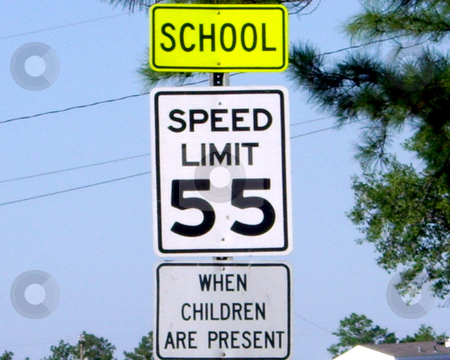 Drive 55 stock photo, Drive 55 school zone sign on Highway 49 near Gulfport, Mississippi. by John Dickinson